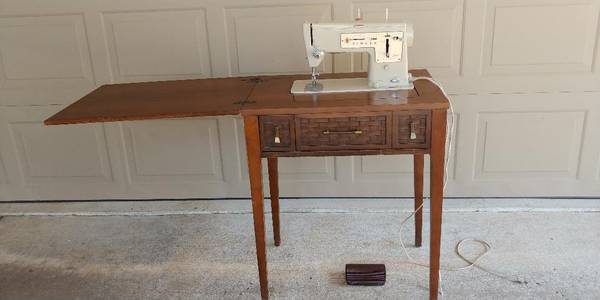 Photo Singer Sewing Machine with Cabinet - $125 (Tulsa)