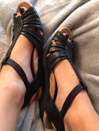 Photo well worn black wedge heels - $75 (Tulsa)