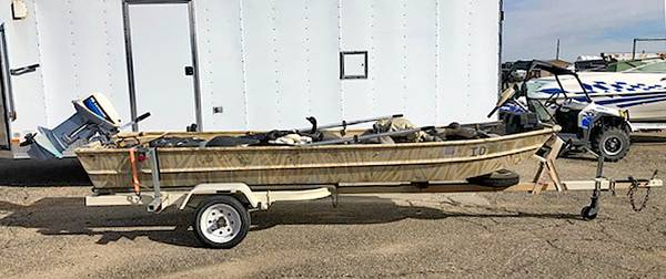 Photo 1439 Sea Nymph Camo Jon Boat with engine, trailer and full of decoys - $2,450 (Kuna)