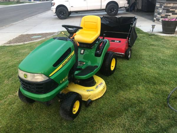 Photo John Deere 21 HP Riding Lawn Mower  Yard Sweeper - $1,300 (Twin Falls)