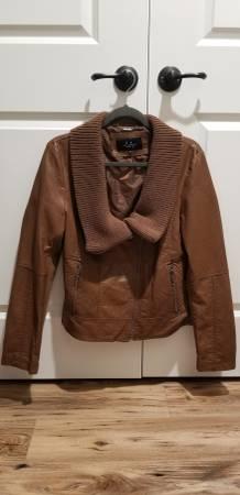 Photo Womens faux leather jacket, large michael kors purse, coach clutch - $25 (Kimberly)