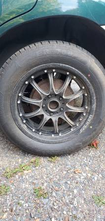 Photo 17 inch rims and tires - $350 (Iron River)