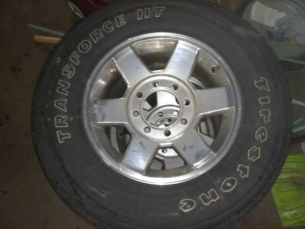 Photo 8 lug Ram rims and tires - $580 (Ishpeming)