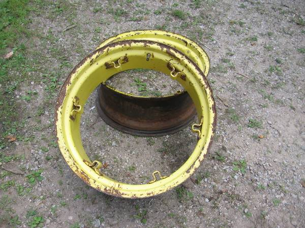 Photo john deere tractor rims 24quot or fire pits - $40 (Rapid River)