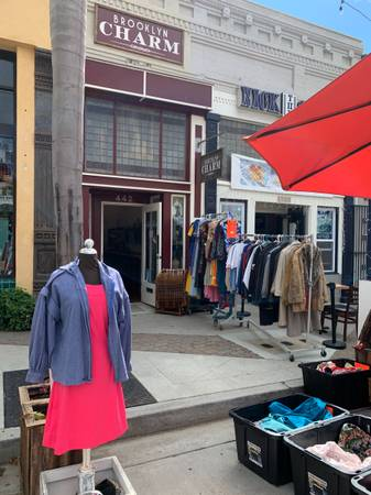 Photo HUGE inventory of New, Used and Vintage Clothing - Garage sale prices (442 East Main St)