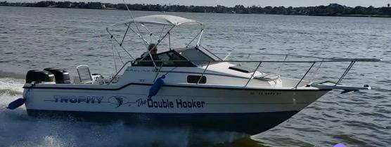 Photo 1991 Bayliner Trophy 23 Walkaround with cuddy cabin. With twin 120HP. - $12,995 (Texas City, Texas)
