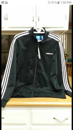 Photo Adidas black and white field soccer jacket with zip pockets - $40 (Visalia)