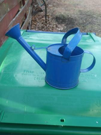Photo Little blue water can - $1 (Wausau)
