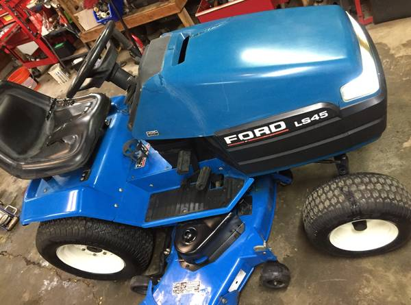 Photo FordNew Holland riding mower - $850 (Murray, Ky)