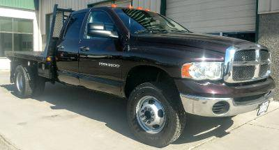 Photo 2005 Dodge Ram 3500 Quad Cab Dually Flatbed 4X4 Cummins Diesel - $18700 (Grand Junction)