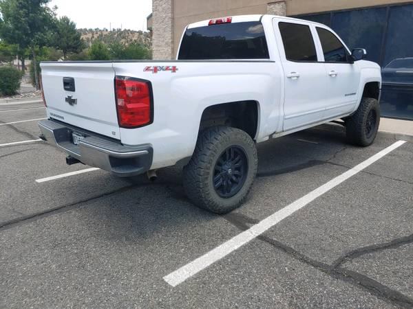 Photo 2017 Chevy Silverado 1500 LT with 6 inch lift - $36000 (Durango)