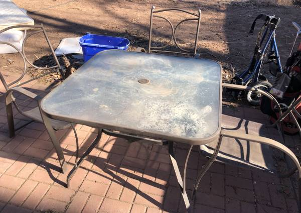 Photo Patio table with 4 chairs - $20 (Grand Junction)