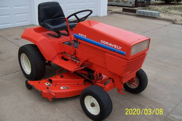 Photo 8123-G Gravely Garden Tractor w 48quot Mower Deck, Blade, Snow Blower - $1,200 (Hoisington vicinity)