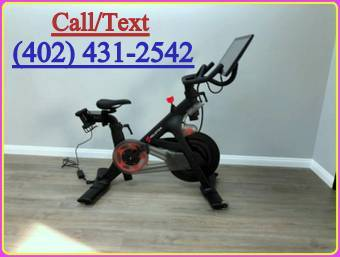 Photo Peloton Bike with weights, shoes and ear buds - $1,000 (wichita)