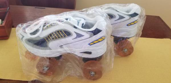 Photo NEW 4-Wheel Roller Skates Mens 6Womens 7 - $35 (Dallas)