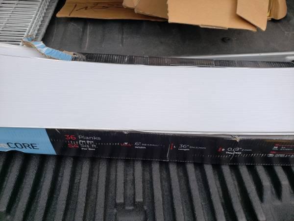 Photo Base Core Peel and Stick White Vinyl Flooring - $40 (Wilmington)