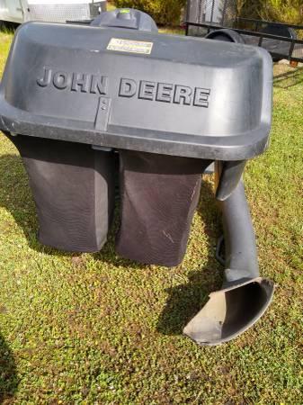 Photo John Deere X300 grass catcher bagger - $175 (shallotte)
