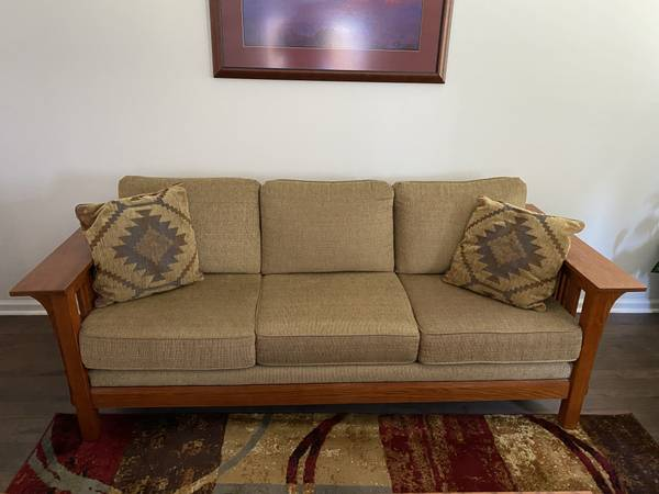 Photo Mission style solid wood couch  recliner, great condition - $350 (Leland)