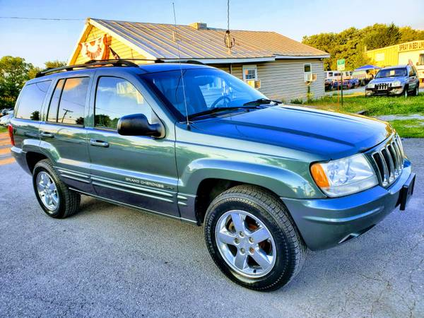 Photo 2003 JEEP GRAND CHEROKEE LIMITED 4x4  FREE 6 MONTH WARRANTY - $5,990 (ROYAL PIKE MOTORS)