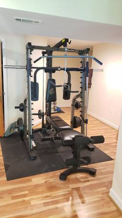 Photo NAUTILUS PRO WORKOUT MACHINE CAGE WITH WORKOUT BENCH AND CAST IRON W. - $950 (CROSS JUNCTION)