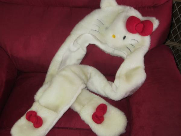 Photo HELLO KITTY SANRIO SNOOD HAT WHITE FUR WITH RED BOWS LONG SIDES WITH M - $20 (WINSTON-SALEM)