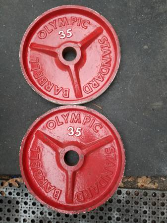 Photo Ivanko 35 lb Olympic weights - $50 (Webster)