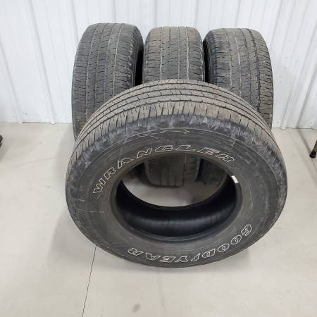Photo set of 4 Goodyear Wrangler 26570R17 tires - $100 (Southern York County)