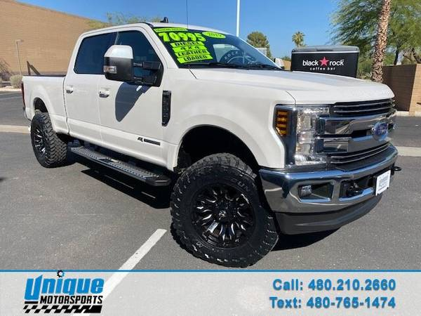 Photo HALLOWEEN SALE PRICES SLASHED LIFTED WHITE 2019 FORD F350 CREW - $65,995 (DELIVERED RIGHT TO YOU NO OBLIGATION)