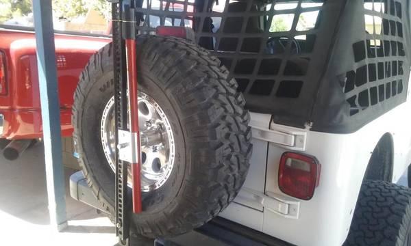 Photo Hi Lift Jack Spare Tire Mount 87-18 Jeep Wrangler YJ, TJ  JK - $50