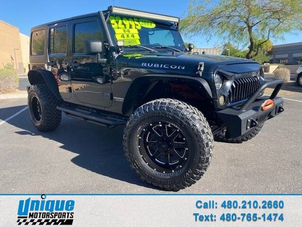 Photo LIFTED LOTS OF EXTRAS 2014 JEEP UNLIMITED RUBICON 4X4 3.6 LTR 285 HO - $32,995 (DELIVERED RIGHT TO YOU NO OBLIGATION)