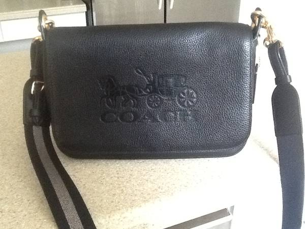 Photo Coach black leather purse - $45 (Glenford)